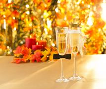 Stock Photo of champagne glasses with conceptual heterosexual decoration