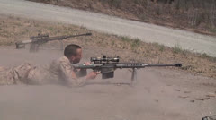 Marine scout snipers practice their marksmanship skills with a 50 cal rifle Stock Footage