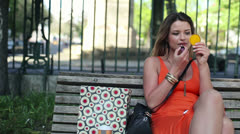 Pretty woman applying pink lipstick on her lips HD Stock Footage