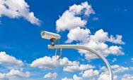 Outdoor cctv camera against blue sky Stock Photos