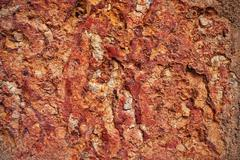 Texture of cracked red clay walls Stock Photos
