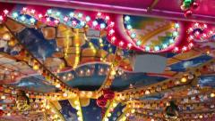 zoom in, lighted funfair/kermis carousel (merry-go-round) - stock footage