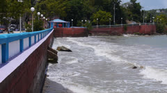 Surf-waves splas hit sea wall in Nauguabo - Puerto Rico.  Stock Footage