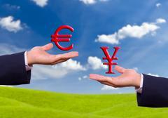 hand exchange euro and yen sign - stock photo