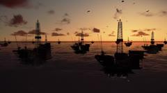 Oil rigs in ocean, timelapse sunrise, tilt - stock footage