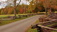 Autumn road wooden fence Stock Photos