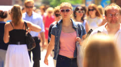 A crowd of people in the summer city. editorial slow motion Stock Footage