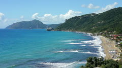 Coastline and beach at Agios Gordis on the island of Corfu - stock footage