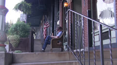 Rocking chair and old man Stock Footage