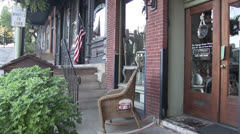 Rocking chair on main street America Stock Footage