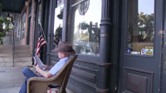 Small town America old reader Stock Footage