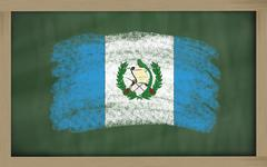 national flag of guatemala on blackboard painted with chalk - stock photo