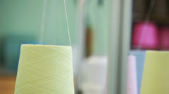 Yellow threads twisted from bobbin - stock footage