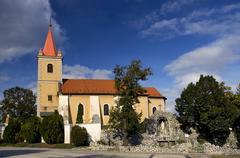 Nice catholic church in eastern europe - village pac Stock Photos