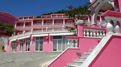 Pink Palace at Agios Gordis in Corfu Greece Stock Footage