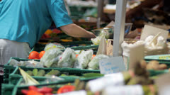 Buying at street market Stock Footage