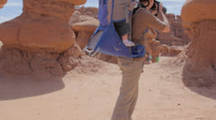 Mother and baby taking pictures in goblin valley state park Stock Footage