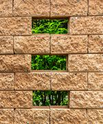 Small Window on Brown Brick Wall Stock Photos