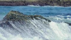 Small wave crash on rocks Stock Footage