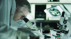 Experienced doctor working in the lab with young medical research students Stock Footage