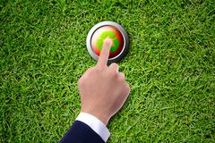 business man hand pushing recycle button - stock photo