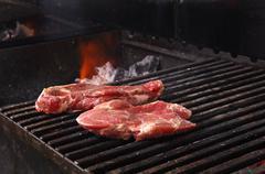 sirloin steak prepared on the barbecue grill. - stock photo