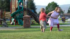Children Palying and Twirling at the Park then they fall. Stock Footage
