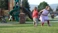 Stock Video Footage of Children Palying and Twirling at the Park then they fall.