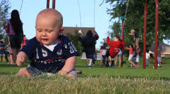 Chubby Baby Boy at the playground Stock Footage