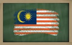 national flag of malaysia on blackboard painted with chalk - stock photo