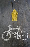 bicycle symbol on street - stock photo