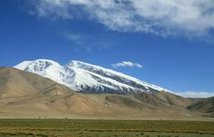 Mount Muztag Ata, the father of ice mountains, on the Pamir Plateau - stock photo
