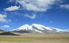 Mount Muztag Ata, the father of ice mountains, on the Pamirs Plateau - stock photo