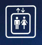White Elevator Sign on Blue Background, Closeup Stock Illustration