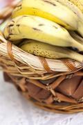 Bunch of bananas in basket Stock Photos