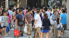 Busy street crossing with multicultural people - stock footage