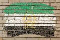 Flag of  afghanistan on grunge brick wall painted with chalk Stock Photos