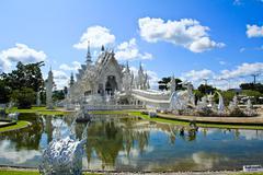 thai temple called wat rong khun at chiang rai, thailand. - stock photo