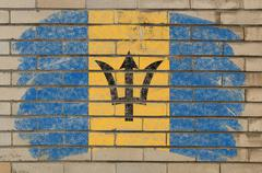 Flag of barbados on grunge brick wall painted with chalk Stock Photos
