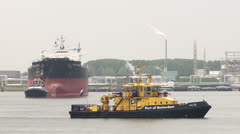 Freighter ship with tugboat and port authority Rotterdam Stock Footage