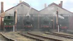 Four vintage steam locomotives, three in steam. Stock Footage