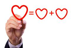 hand writing love mathematical equation  of heart - stock photo