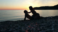 Stock Video Footage of Couple on the shore of the sea, Romantic Couple at Sunset.
