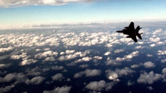 F-15 Eagle fighter jet above the clouds - stock footage