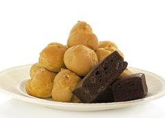 Cream puffs and brownie Stock Photos