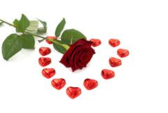 Red rose and heart shape chocolate Stock Photos