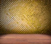 golden mosaic wall and wood floor - stock photo