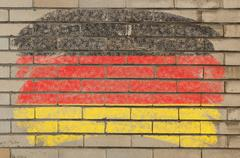 flag of germany on grunge brick wall painted with chalk - stock photo