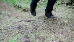 Unrecognizable man walking on a forest path. - stock footage