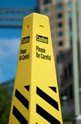 yellow rubber caution cone in the zone - stock photo